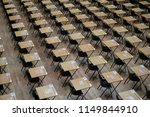 Hall With Empty Wooden Desks...