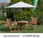 Table  Chairs And Umbrella...