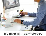 graphic designer working with... | Shutterstock . vector #1149899960