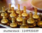 pour water of dedication brass... | Shutterstock . vector #1149920339
