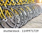 Row Of Bicycles Parked. Yellow...