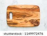 rustic wood cutting board on... | Shutterstock . vector #1149972476
