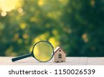 house and magnifying glass.... | Shutterstock . vector #1150026539