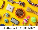 Stock photo bowl with food for cat or dog and accessories on color background pet care 1150047029