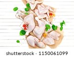 raw chicken meat on cutting... | Shutterstock . vector #1150061099