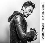 elegant young handsome man.... | Shutterstock . vector #1150077803