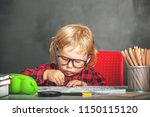 kid is studying. happy cute... | Shutterstock . vector #1150115120