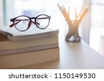 close up red eyes glasses on... | Shutterstock . vector #1150149530