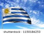 national flag of uruguay on a... | Shutterstock . vector #1150186253