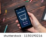 a woman is shopping at the... | Shutterstock . vector #1150190216