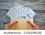 hands of a woman holding an...   Shutterstock . vector #1150198130