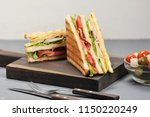 classic club sandwich with ham... | Shutterstock . vector #1150220249
