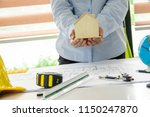engineering woman holding ... | Shutterstock . vector #1150247870