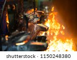 metal pouring in casting line... | Shutterstock . vector #1150248380