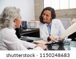 smiling female doctor in... | Shutterstock . vector #1150248683