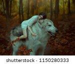 A Fragile Girl Riding A Wolf ...