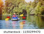 happy boy kayaking with his... | Shutterstock . vector #1150299470