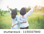 two women are standing in a... | Shutterstock . vector #1150337840