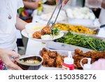 scooping the food   Shutterstock . vector #1150358276