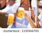 filling glass with beer. happy... | Shutterstock . vector #1150366703