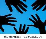 dark hands in a blue sky | Shutterstock . vector #1150366709