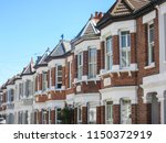 a row of british red brick... | Shutterstock . vector #1150372919