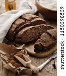 homemade sliced round rye bread ... | Shutterstock . vector #1150398539