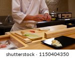 professional sushi chef... | Shutterstock . vector #1150404350