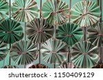 abstract folded fabric pattern... | Shutterstock . vector #1150409129