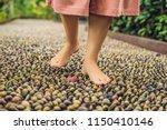 woman walking on a textured...   Shutterstock . vector #1150410146