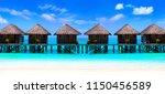 water villas on wooden pier in... | Shutterstock . vector #1150456589
