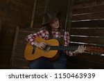 a girl in a cowboy hat and... | Shutterstock . vector #1150463939