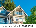 a perfect neighborhood. houses... | Shutterstock . vector #1150475039