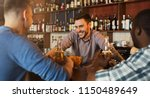 male friends drinking beer and... | Shutterstock . vector #1150489649