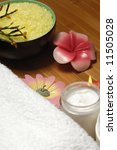 bath towel, aromatic candles and cream - stock photo