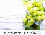white grapes on the white...   Shutterstock . vector #1150516730