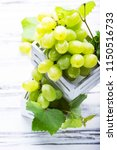 white grapes on the white...   Shutterstock . vector #1150516733