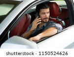 handsome man using phone while... | Shutterstock . vector #1150524626