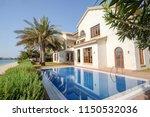 villa on palm jumeirah ... | Shutterstock . vector #1150532036
