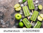 green popsicles on a rustic... | Shutterstock . vector #1150539800