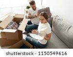 happy young couple having fun... | Shutterstock . vector #1150549616