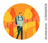 man hiking in autumn forest.... | Shutterstock .eps vector #1150560920