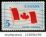 CANADA - CIRCA 1965: Mail stamp printed in Canada featuring the national maple leaf flag, circa 1965 - stock photo