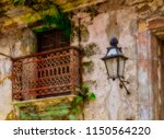 window and streetlamp in a... | Shutterstock . vector #1150564220
