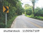 road leading up into the high... | Shutterstock . vector #1150567109