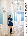 charming brunette girl standing ... | Shutterstock . vector #1150590380