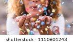 beautiful defocused woman blow... | Shutterstock . vector #1150601243