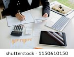 woman with bills and calculator.... | Shutterstock . vector #1150610150