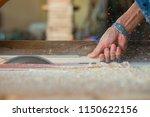 the carpenter's hand are... | Shutterstock . vector #1150622156