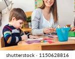 preschool teacher with children ... | Shutterstock . vector #1150628816